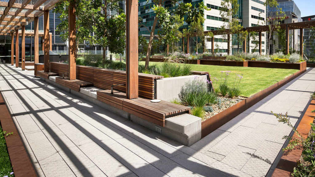 Custom exposed aggregate paving by Anston Architectural at Skypark, Melbourne Quarter.
